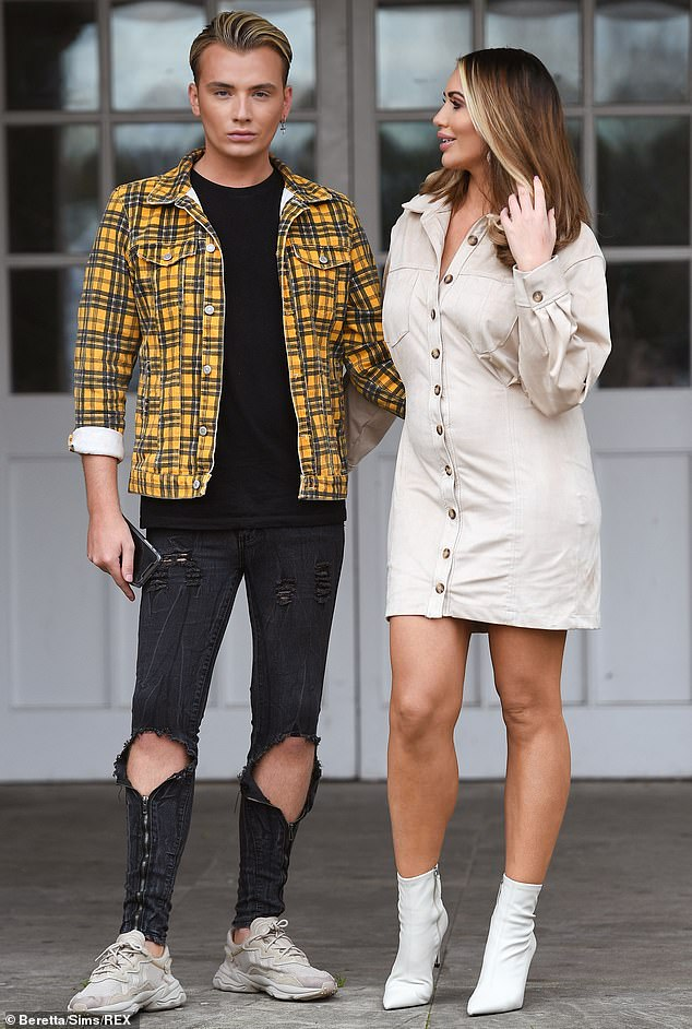 Close:Amy Childs, 30, looked delighted as she hugged her cousin and makeup artist Harry Derbridge, 26