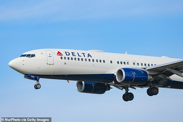 As she slept on the Delta flight, the woman felt warm liquid falling on her