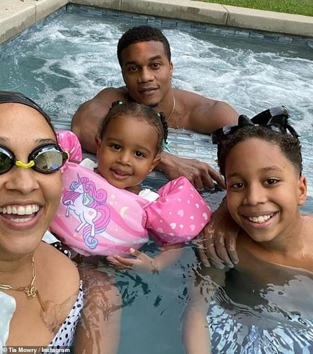 Hardricts: The Sister Sister actress enjoys a family pool day with husband Cory, and two kids Cairo and Cree; pictured September