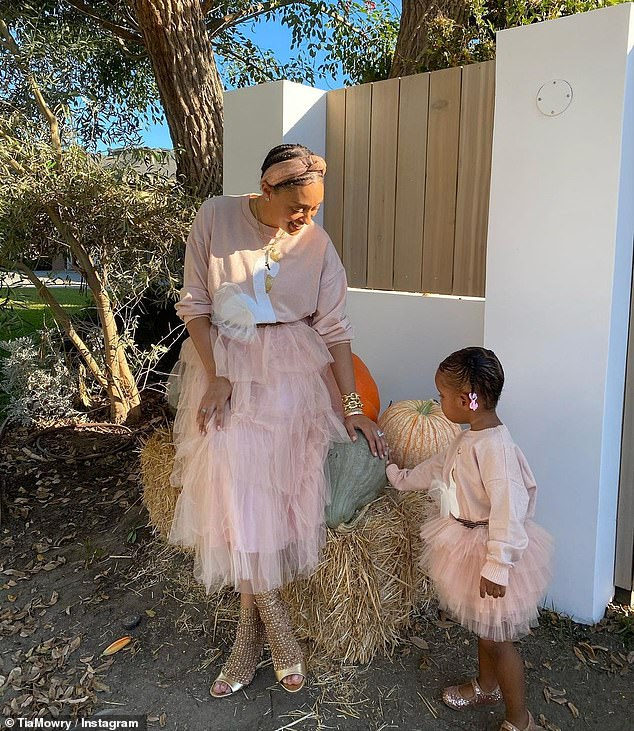 Pink ladies: The Family Reunion actress showed off her stunning pumpkin display as she and Cairo sparkled in shades of pink and gold