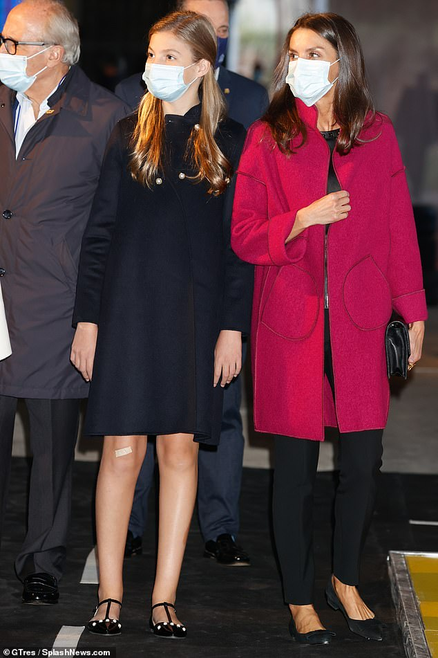 13-year-old Princess Sofia opted for a monochrome ensemble that sported a sleek black coat over a white polka dot top - and had a plaster on her right knee