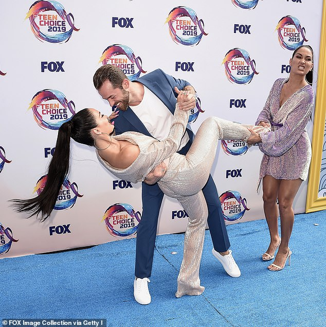 Sparks would eventually fly: Nikki and Artem started dating about seven months after she and John Cena split for the last time in July 2018; they are pictured with Nikki's twin sister Brie