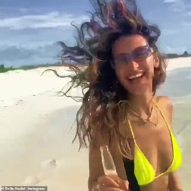 Making waves: Hadid couldn't have looked happier as she frolicked in the sunshine