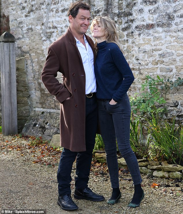 Nothing to see here: On Tuesday, Dominic and his wife Catherine insisted their 'marriage was strong' as they took part in a bizarre photocall outside their home