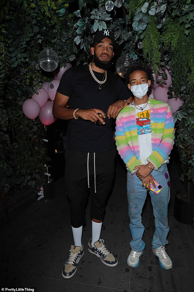 Pals: Jaden also posed up a storm alongside a very tall Karl-Anthony