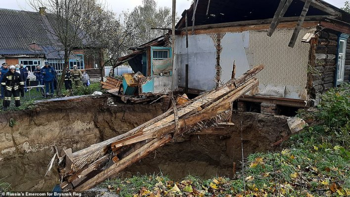 Cranes and special teams have been brought in to assist with clearing debris left by the ruined house in the Russian village of Vyshkov