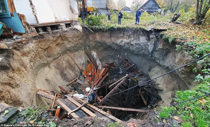 Search teams from Emercom, Russia's emergency ministry, used special equipment to clear debris and search the sinkhole