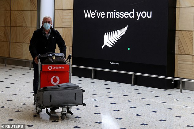 Passengers were greeted with a sign that read 'we've missed you' as they made their way through the terminal to their loved ones