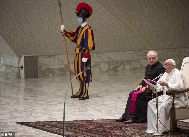 A member of the Swiss Guard stands next as Francis (right) addresses his supporters on Wednesday. The smallest army in the world, the Swiss Guard was formed in 1506 to protect the Pope