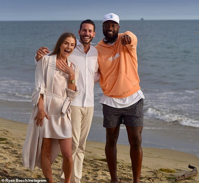 Happiness: Wade posed with the couple after he photobombed the pair with the most genuine reaction