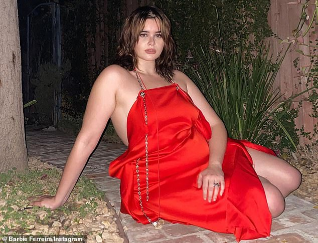 Sizzling:Euphoria's Barbie Ferreira radiated sexiness in a crimson dress with a thin string as a halter and chain details spilling down the front