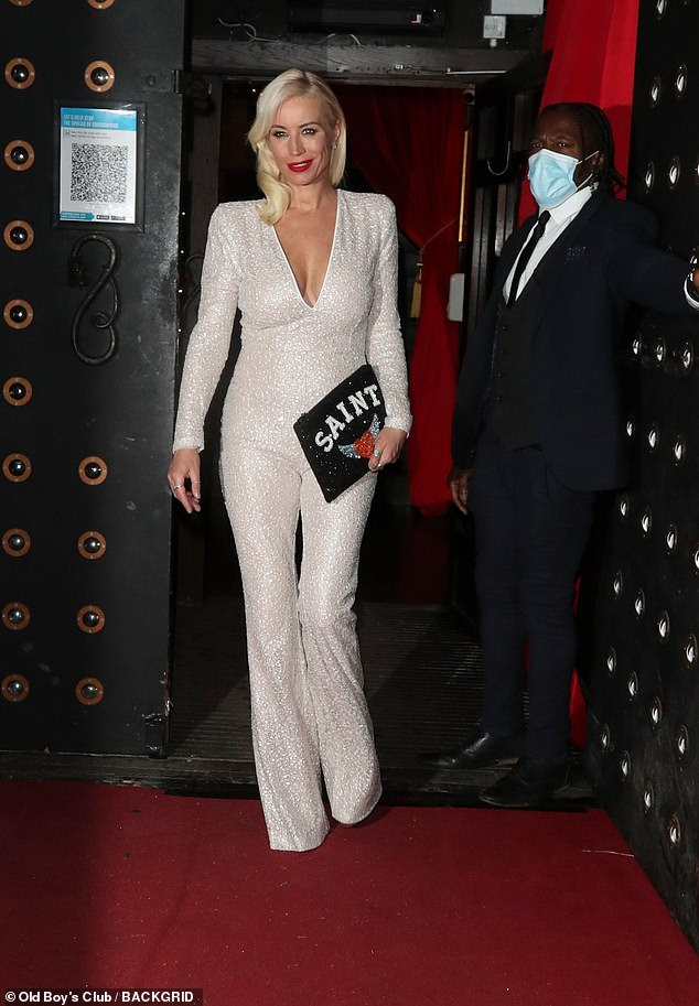 Looking good: Denise was sure to flaunt all her assets in the statement sparkling jumpsuit