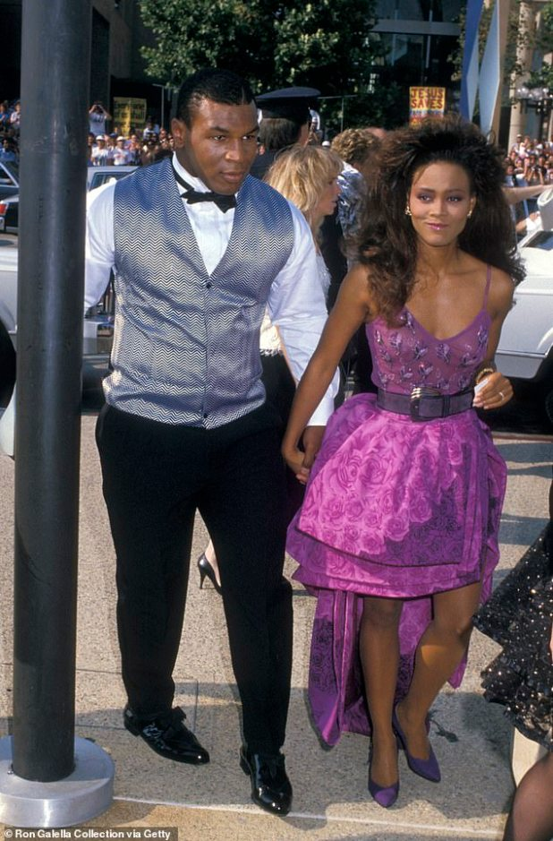Exit: Robin divorced Mike in 1989, just eight months after the marriage because he claimed that Boxer had indiscriminately abused him, both verbally and physically;  Mike and Robin portrayed in 1988