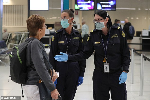 'We have people being allowed in from another country and we were the last ones to find out about it,' Mr Andrews said (pictured, ABF officer check a New Zealand passenger at Perth Airport on March 18)