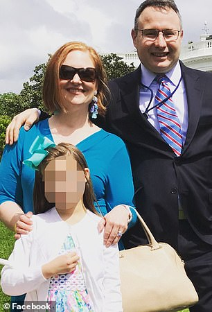 Rachel and Alex Vindman pictured with their daughter in front of the White House