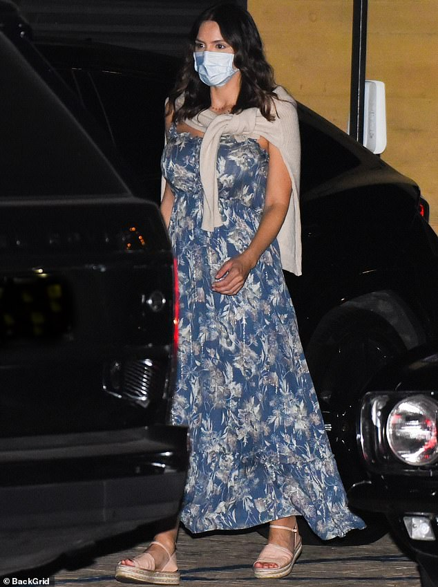 So chic:Katherine opted for an attractive blue and grey floral number, wrapping a tan sweater around her neck