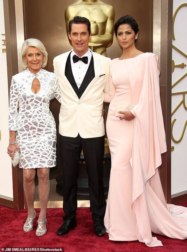 Supportive: Matthew told the Times Magazinethat despite a tumultuous life he's 'more reliable that anyone in his family' (pictured with his mum Kay and wife Camila Alves in 2014)