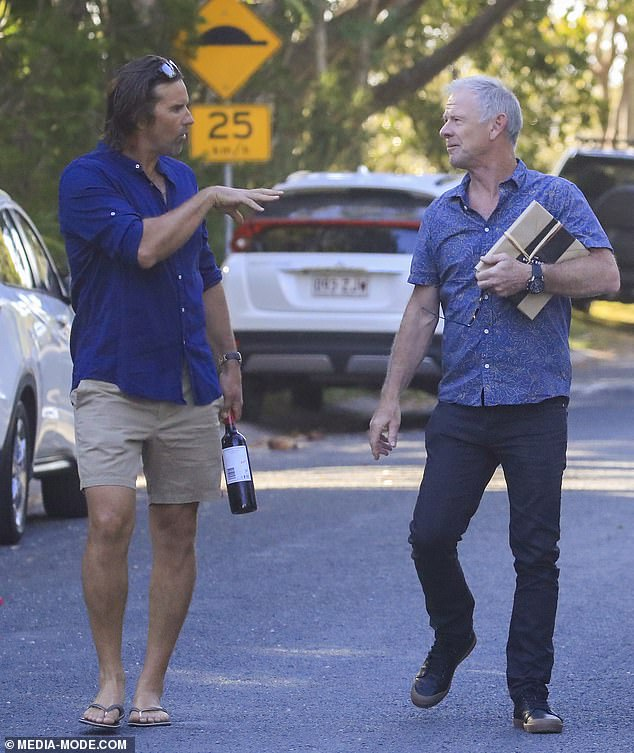 Styled: Craig sported a pair of black denim jeans and a blue patterned short sleeved collared shirt. He was also carrying a wrapped present. Meanwhile Pat, went casual in tan shorts and a navy button up shirt with thongs