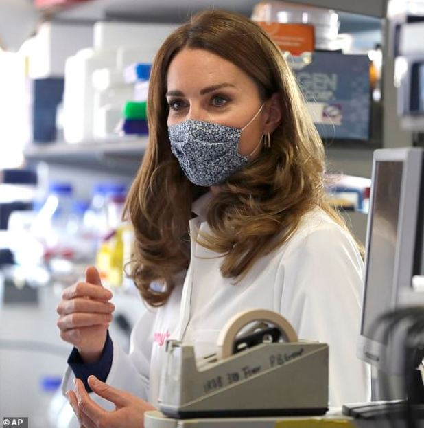 The 38-year-old Duchess of Cambridge took a tour of the Institute of Reproductive and Development Biology at Imperial College London on Wednesday, where she heard about the work of national charity Tommy, gave her a lab coat and a blue floral face mask.