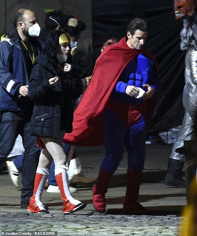 What's going? Superman looks set to make a surprise appearance in The Batman, as costumed extras filmed scenes for a Halloween party in Liverpool on Friday