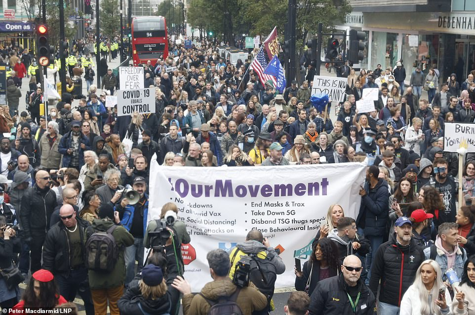 Thousands of protesters gathered in Oxford Street today to demonstrate against the Covid lockdown rules as Londoners begin life under new Tier 2 restrictions