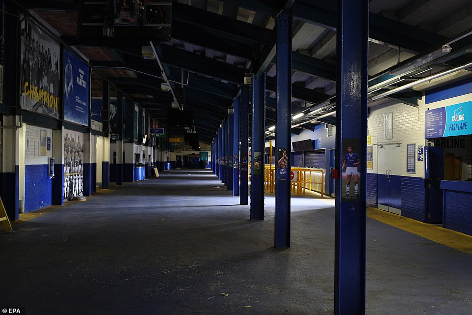 Liverpool has one of the most severe coronavirus rates in the country and is one of only two regions in the highest alert level. Pictured: An empty Goodison Park stadium today as the Merseyside Derby got underway