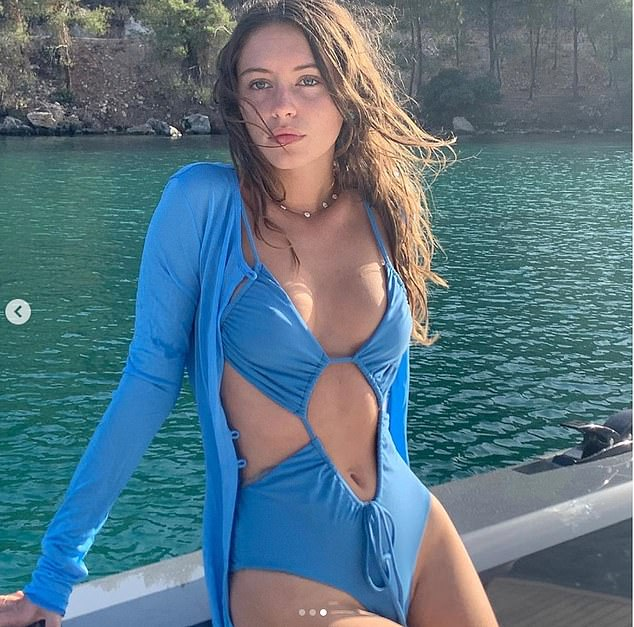 Shades of blue:She highlighted her stunning blue eyes with the racy one-piece, which she paired with a matching cardigan