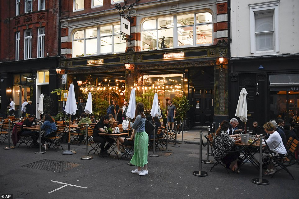 Restaurants in Covent Garden would normally be packed with visitors (pictured) before the Tier 2 restrictions meaning people from different households can't meet indoors