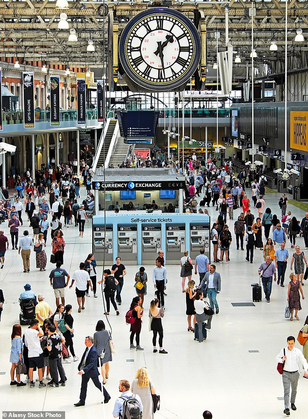 Recent studies have suggested that only about one in every five people who catch Covid-19 actually gives it to someone else (pictured: people at London's Waterloo station)
