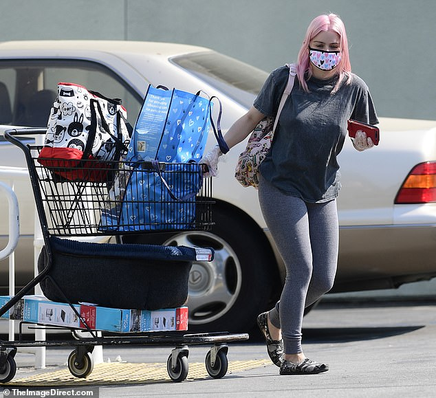 Hands full: Ariel Winter, 22, keeps it comfortable in leggings and a baggy t-shirt for a large Petco run on Saturday. The Modern Family actress suited up in gloves and a mask, as she pulled a cart full of supplies for her four dogs at home