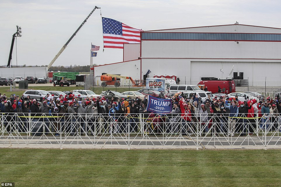 Supporters of President Donald J. Trump wait in line to participate in his campaign rally at the Southern Wisconsin Regional Airport in Janesville, Wisconsin on Saturday
