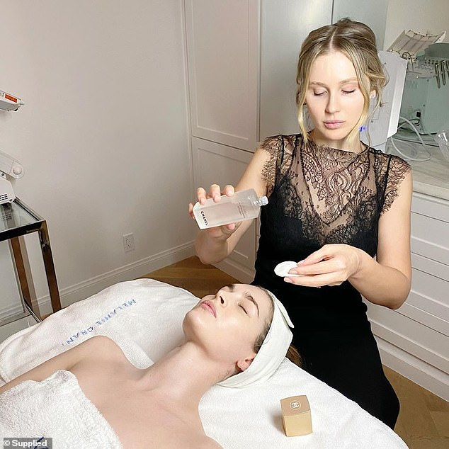 The facialist (pictured at work) said she snacks on nuts, dark chocolate and peppermint and English breakfast tea while working