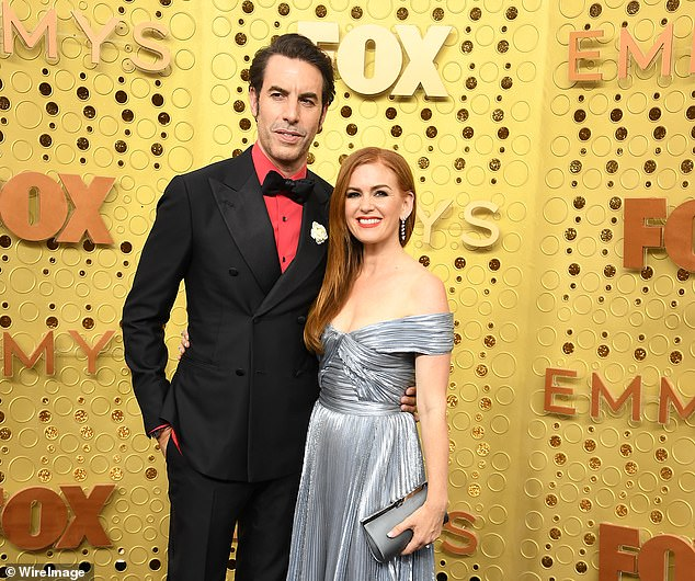 Cohen, who lives with wife Isla Fisher (pictured together), in Los Angeles, said that he has seen a change in American society since he filmed the first Borat movie in 2005