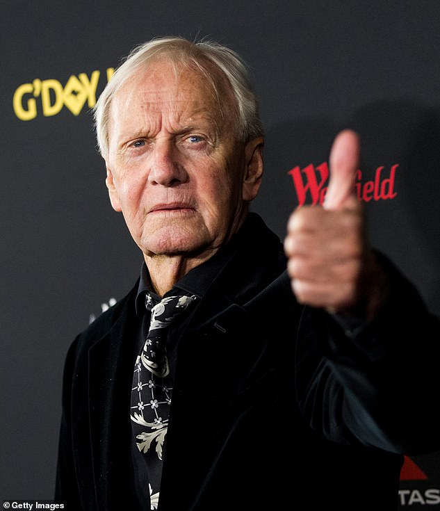 'I'm about to thump the guy that owns the whole network': Crocodile Dundee's Paul Hogan, 81, (pictured) revealed how a punch-up with Kerry Packer's brother Clyde in the 1970s almost RUINED his career
