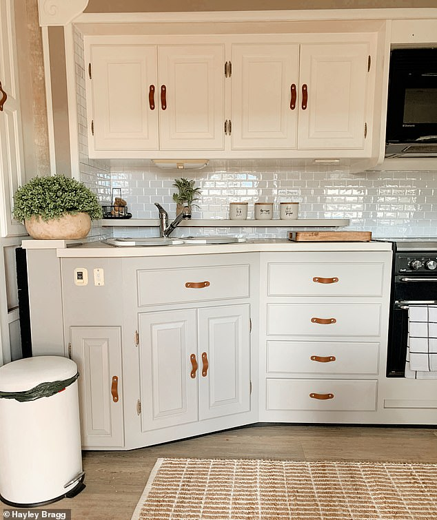 The pair added a chic splashback along the kitchen bench and used leather straps as the handles on their cupboards