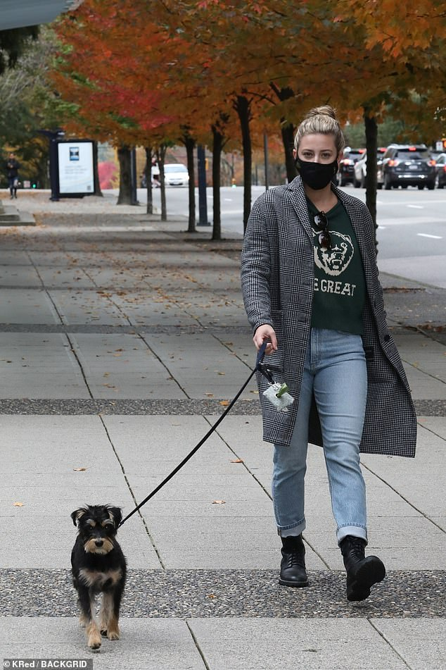 Four-legged family members: Lili Reinhart, 24, took her beloved pet pooch Milo for a walk on a chilly autumn morning in Vancouver, Canada on Saturday