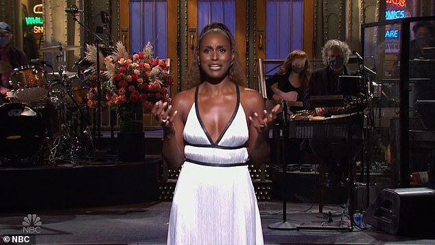 Prom date: Issa kicked things off in a stunning white dress, likening the last four years of her show Insecure during her opening monologue to high school, and hosting SNL to her prom