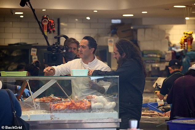 Fishy dare: They pair had earlier been inside the supermarket together