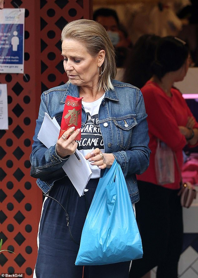 A handful: She had bags in her hands as well as a pen and what looked like a script or list