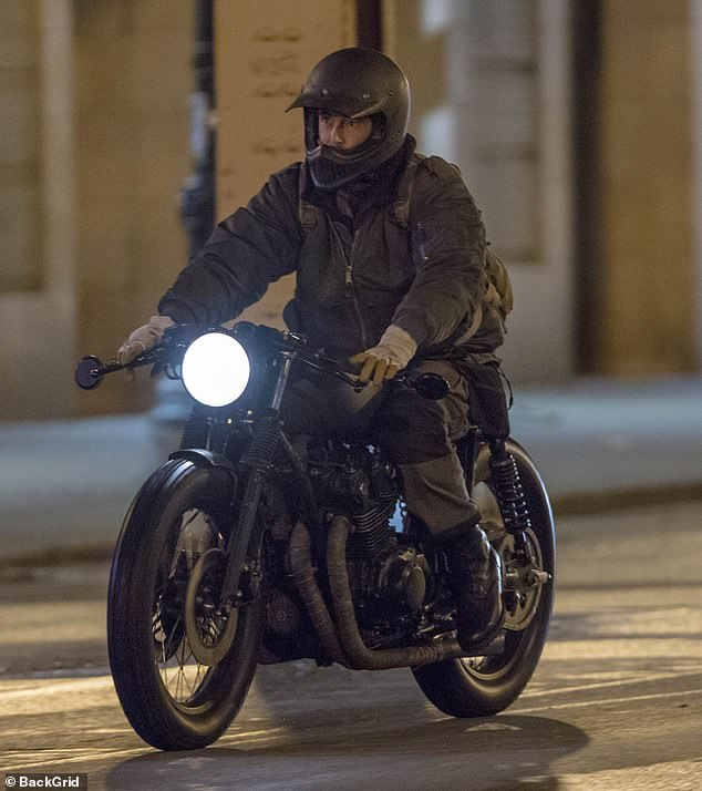 Character: Colin was dressed in a brown jacket and matching trousers while he had a large bag strapped to his back for the nighttime shoot