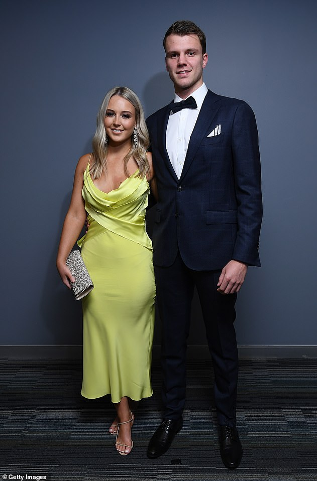 Mellow:Jordan Ridley of the Bombers and his partner Rachel Mewett brought some brightness to the occasion with Rachel picking a bright yellow, satin gown