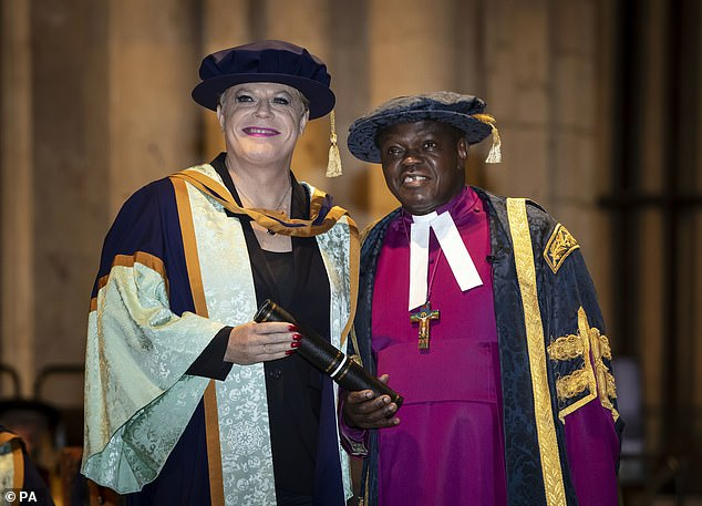 Labour MP David Lammy accused the Government of displaying 'blatant institutional prejudice' in its snubbing of Sentamu (pictured giving Eddie Izzard his honorary degree from York St John University