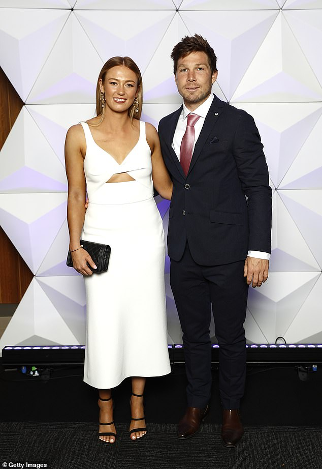 Good looking!Toby Greene of the Giants and partner Georgia Stirton also went for a black and white look, with Toby in a black suit with a pink satin tie