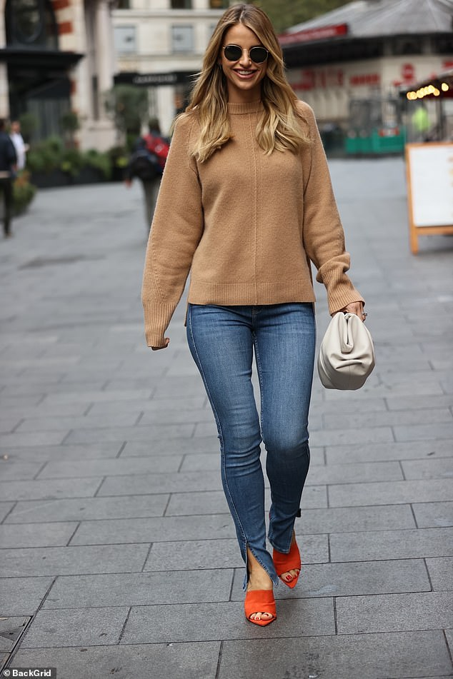 Autumnal chic:Vogue Williams dressed for comfort on Sunday as she headed out in London bright and early to host her Heart Radio show