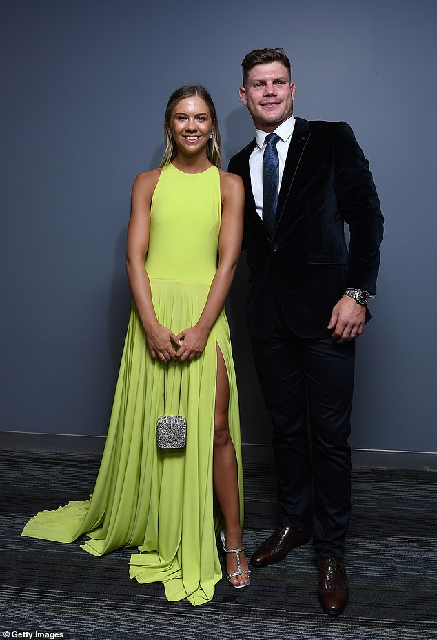Ready for fun:Taylor Adams of the Magpies and his partner Ellie Thornycroft made a fine pair with Taylor wearing a velvet tux with a chunky watch