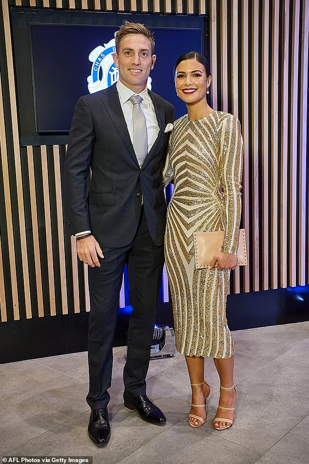 All that glitters:West Coast Eagles player Brad Sheppard and partner Ellen Taylor-Hawkins looked glam with Ellen wearing a fitted, art deco inspired gown with fine gold sequins