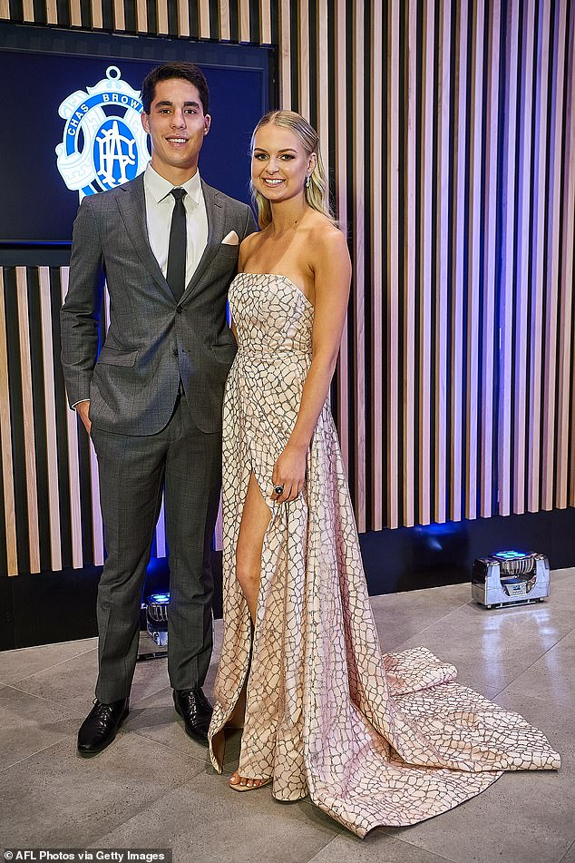 Trendy:Fremantle star Adam Cerra and partner Claudia Piva looked classy with Adam in a grey suit and Claudia in a floor-length, sleeveless dress with a crackle pattern