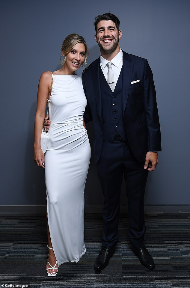 What a pair:Melbourne player Christian Petracca took along partner Isabella Beischer, who chose a skin-tight while frock that showed off her slim physique