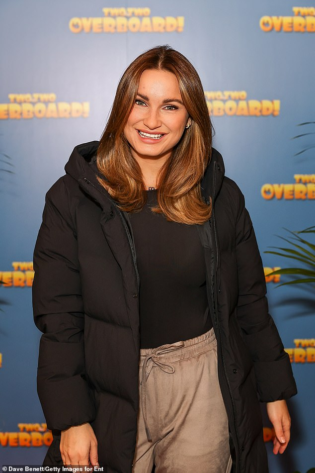 Grinning: Sam wore her silky raven tresses in loose waves, as she smiled to pose for photos at the Everyman Cinema in Chelsea