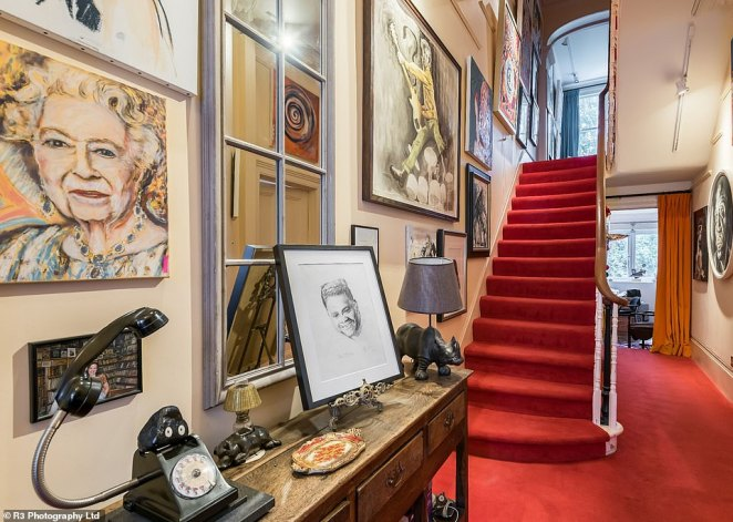 Ronnie's home is scattered with artwork, from sculptures and telephones of rhinos, to landscape paintings. His hallway (pictured) features red carpet and amulticoloured portrait of The Queen